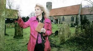 Mrs Jean Samuels in Belton churchyard with Mr Robert Pole's diary